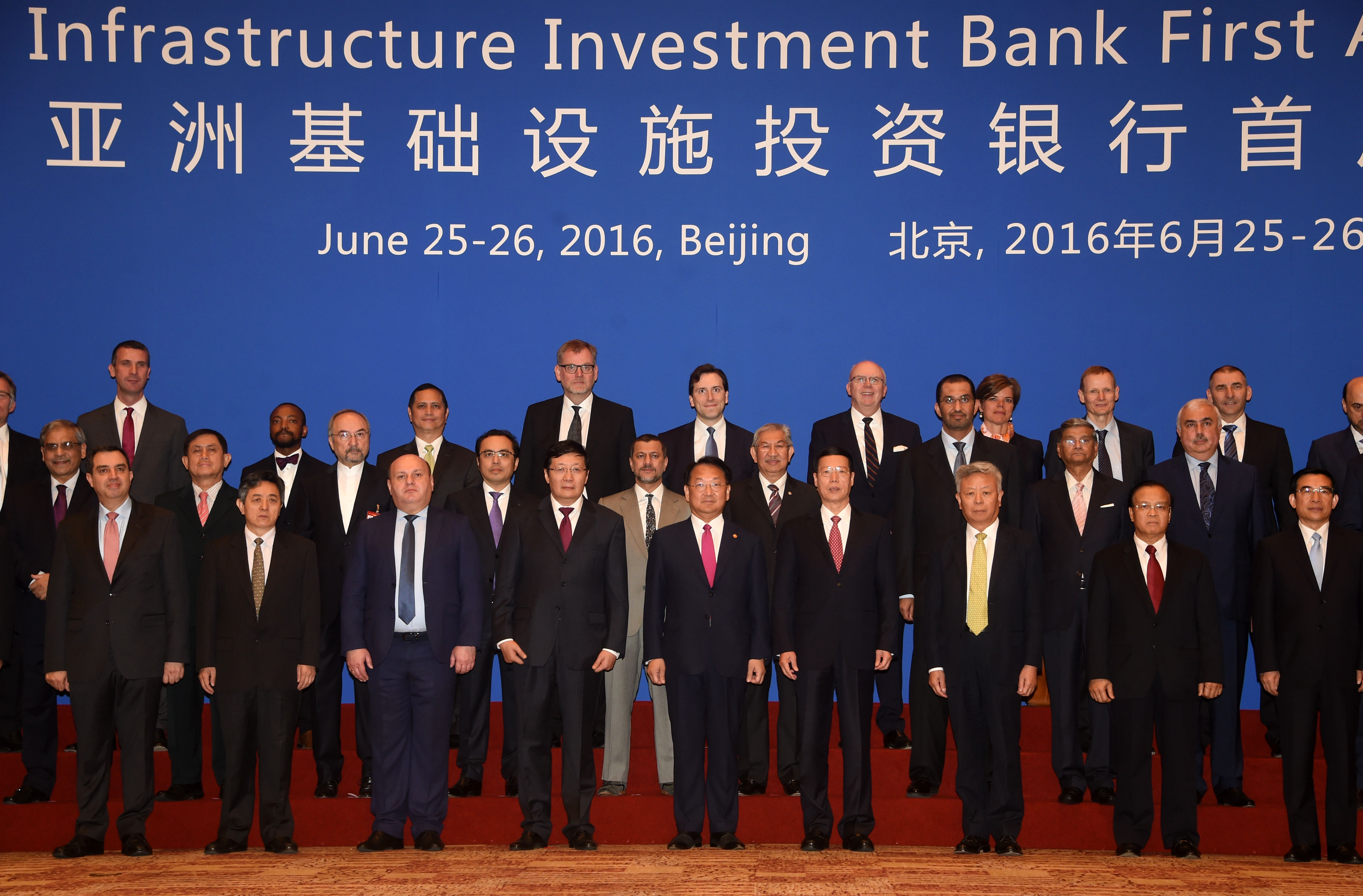 Deputy Prime Minister Yoo poses for first AIIB Annual Meeting group photo